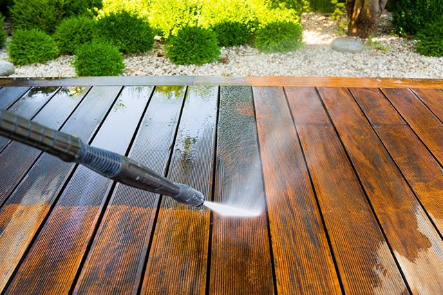 cleaning deck with pressure washer